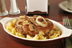 Salisbury steak on noodles Stock Image