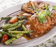 Salisbury Steak Patties With vegetables. Salisbury Steak Patties With Roasted Asparagus Tomatoes And Potatoes stock image