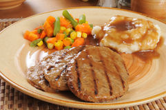 Salisbury steak with potatoes and gravy Stock Photos