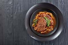 Salisbury steaks on plate, top view royalty free stock photos