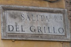 Salita del Grillo street name sign in Rome, Italy. Salita del Grillo is one of the most ancient streets of Rome, between Piazza del Grillo and Largo Angelicum Stock Photos