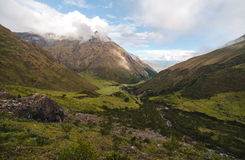 Salkantay Camp - Peru. Campsite nestled among the tall peaks that line the Salkantay Trail in Peru Royalty Free Stock Image