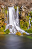 Sall water fall flowes into a creek Stock Images