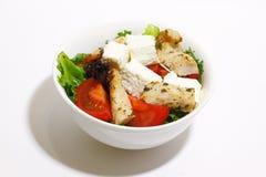 Sallad med den fega filén, tomaten och feta Arkivfoton