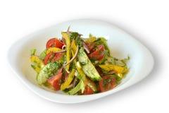 Salladen för den nya grönsaken på vit isolerade bakgrund Royaltyfri Foto