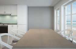 Salle à manger et cuisine de vue de mer dans la maison de plage de luxe image stock