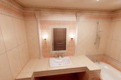 Salle de bains rose Photos stock