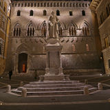 Sallustio Bandini on Piazza Salimbeni at night, Siena, Tuscany - Italy. Royalty Free Stock Photo