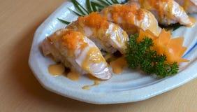Salmões do sushi do foco no prato Imagem de Stock Royalty Free