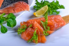 Salmom - fish delicacy. Salmon is a fish that is served with pleasure. Fish that is eaten in any form: fried, steamed, grilled, pickled ...n Stock Photography
