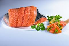 Salmom - fish delicacy. Salmon is a fish that is served with pleasure. Fish that is eaten in any form: fried, steamed, grilled, pickled ...n Stock Photo