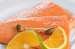 Salmon. Raw salmon fish with caper and orange Royalty Free Stock Photography