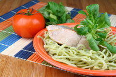 Salmon. With noodles on plate with vegetable Royalty Free Stock Images