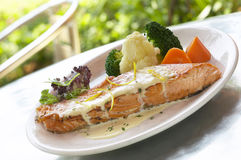 Salmon. A dish of roasted salmon with carrot and broccoli royalty free stock photography