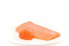 Salmon. Marinated salmon with red caviar Stock Image
