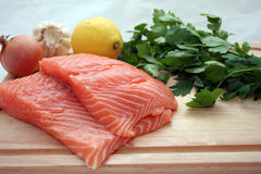 Salmon. Two fresh salmon filets on a wooden cutting board Stock Images