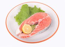 Salmon. Lettuce and lemon royalty free stock images