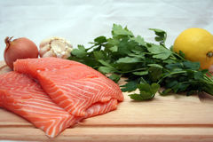 Salmon. Two fresh salmon filets on a wooden cutting board Stock Photo