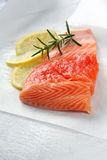 Salmon. Fillet, ready for cooking, with lemon and rosemary Royalty Free Stock Photos
