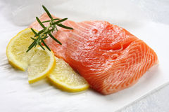 Salmon. Atlantic salmon steak with lemon and rosemary.  Ready for cooking Stock Photos