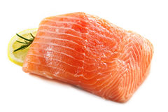 Salmon. Atlantic salmon fillet, ready for cooking.  With lemon and rosemary, isolated on white Stock Image