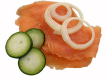 Salmon. Delicious salmon with English cucumber and onion rings isolated on white studio background Royalty Free Stock Images