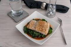 Salmon alla puttanesca. 2018-10-31 - Salmon alla puttanesca with chard stock photos
