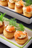Salmon appetizer with dill dip in puff pastry on stone tray Royalty Free Stock Photography