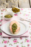 Salmon appetizer filled with green sauce Royalty Free Stock Photos