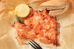 Salmon appetizer. Salmon in parchment with lemon and bread roll Royalty Free Stock Photos
