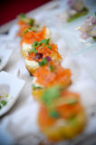Salmon appetizers. A closeup of smoked salmon appetizers, arranged in a row Royalty Free Stock Image
