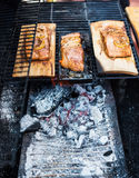 Salmon on an apple wooden plank on the grill royalty free stock photos