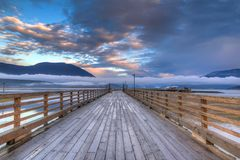 Salmon Arm Wharf on a cloudy morning sunrise. Stock Images