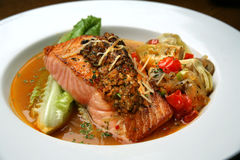 Salmon with Artichoke and Tomato Salsa Stock Photos