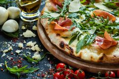 Salmon and arugula pizza light weight meal. Salmon and arugula pizza. Light and tasty meal for weightwatchers royalty free stock photo