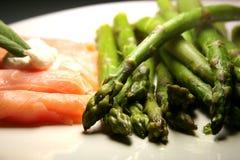 Salmon and asparagus. Smoked salmon with fresh green asparagus - low-calorie ensemble stock image