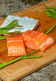 Salmon and Asparagus. Fresh Salmon and Asparagus on bamboo cutting board stock photo