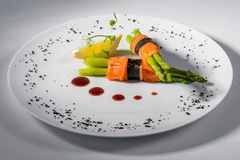 Salmon asparagus lemon. Salmon with asparagus and lemon stock images