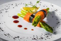 Salmon asparagus lemon. Salmon with asparagus and lemon stock photography
