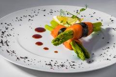 Salmon asparagus lemon. Salmon with asparagus and lemon stock photos