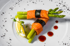 Salmon asparagus lemon. Salmon with asparagus and lemon royalty free stock image