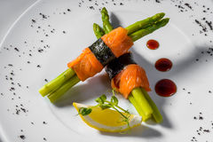 Salmon asparagus lemon. Salmon with asparagus and lemon royalty free stock photos