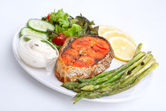 Salmon with asparagus, lemon and sauce Stock Images