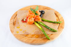 Salmon asparagus olives. On the wood plate Stock Images