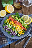 Salmon, avocado, corn, cucumber and onion salad Stock Image