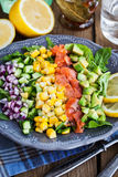 Salmon, avocado, corn, cucumber and onion salad Royalty Free Stock Image