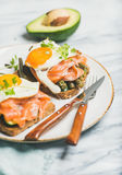 Salmon, avocado, fried egg, sauted green beans and sprouts sandwiches Royalty Free Stock Photos