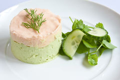 Salmon & Avocado Mousse. Garnished with dill and served with peashoots & cucumber Stock Photography