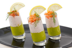 Salmon and avocado mousse on black plate Royalty Free Stock Image