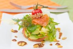 Salmon and avocado salad garnish with cedar nut dressing Royalty Free Stock Photos